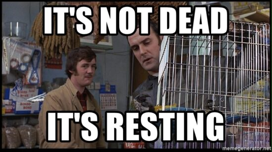 Image from Monty Python's Dead Parrot Sketch with text: It's not dead; it's resting