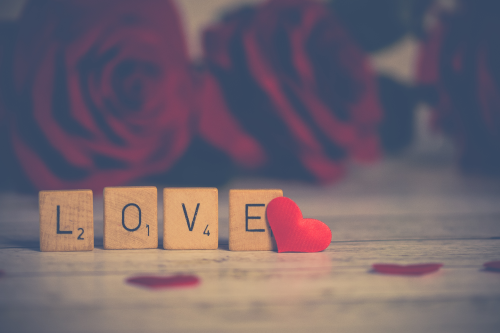 Love in scrabble tiles with heart